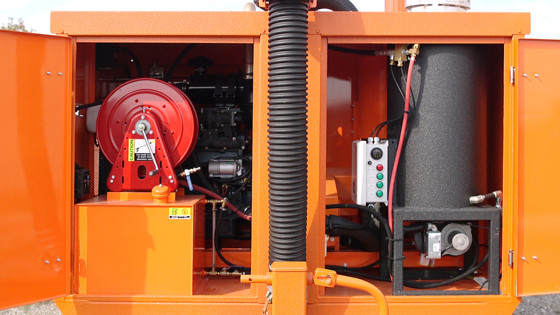 Enclosed hose reel in heated compartment for winter use.